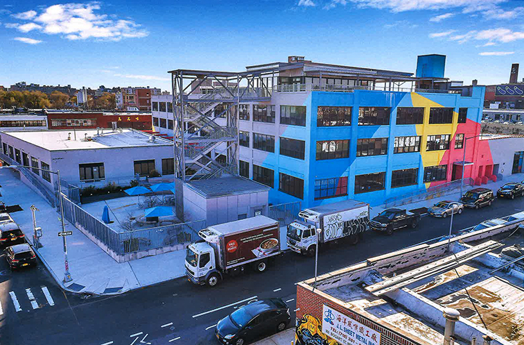 Old industrial building in Williamsburg, Brooklyn transformed into trendy mixed  use structure